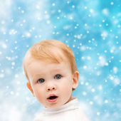 Happy little boy in winter clothes — Stock Photo