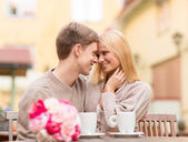 Romantic happy couple kissing in the cafe — Stock Photo