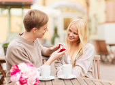 Romantic man proposing to beautiful woman — Stock Photo