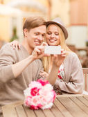 Couple taking picture with smartphone — Stock Photo