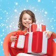 Happy child girl with gift boxes — Stock Photo