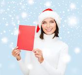 женщина в шляпе санта помощник с пустым красная карточка — Стоковое фото