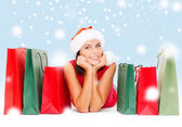 Woman in red shirt with shopping bags — Stock Photo