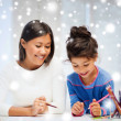 Mother and daughter drawing — Stock Photo #33608105