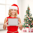 vrouw in helper kerstmuts met tablet pc — Stockfoto #33608143