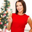 Woman in red dress with a glass of champagne — Stock Photo