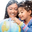 Mother and daughter with globe — Foto Stock