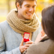 Man proposing to a woman in the autumn park — Stock Photo