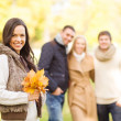Group of friends having fun in autumn park — Stock Photo #33609087