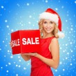 Woman in santa helper hat with red sale sign — Stock Photo #33609507
