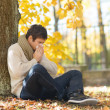 Stock Photo: Ill mwith paper tissue in autumn park