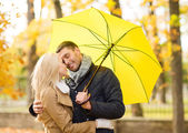 Romantic couple kissing in the autumn park — Stock Photo