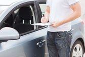 Man with car documents — Stock Photo