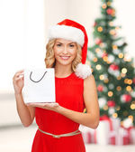 Woman in red dress with shopping bag — Stock Photo