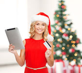 Woman with tablet pc and credit card — Stock Photo
