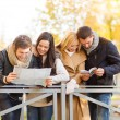 Couples with tourist map in autumn park — Stock Photo