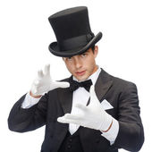 Magician in top hat showing trick — Stock Photo