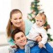 Foto Stock: Happy parents playing with adorable baby