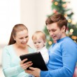 Parents and adorable baby with tablet pc — 图库照片
