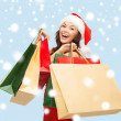 Woman in red dress with shopping bags — Foto Stock