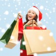 Woman in red dress with shopping bags — Stockfoto