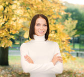 Smiling woman in white sweater — Stock Photo