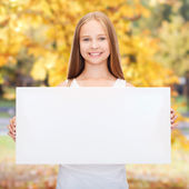 Little girl with blank white board — Stock Photo