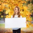 Little girl with blank white board — Stockfoto