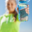 Woman showing a bottle of water — Stock Photo #33824031