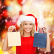 Woman in red dress with shopping bags — Stock Photo #33824509