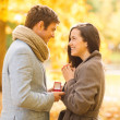 Man proposing to a woman in the autumn park — Стоковая фотография