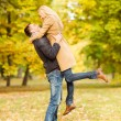 Romantic couple playing in the autumn park — Stock Photo
