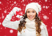 Smiling woman in mittens and hat with jingle bells — Stock Photo