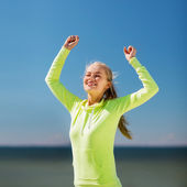 Woman runner celebrating victory — Stock Photo