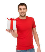 Smiling man in red shirt with gift box — Stock Photo