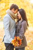 Romantic couple kissing in the autumn park — Stock Photo