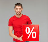 Man in shirt with red percent sale sign — Stock Photo