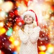 Dreaming girl in santa helper hat — Stock Photo