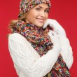 Stock Photo: Woman in hat, scarf and mittens