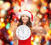 Woman in santa helper hat with clock showing 12 — Stock Photo