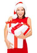 Kobieta w santa hat pomocnika z wielu prezentowe — Zdjęcie stockowe