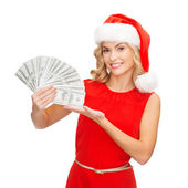 Woman in santa helper hat with us dollar money — Stock Photo