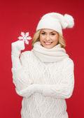 Woman with big snowflake — Stock Photo