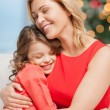 Hugging mother and daughter — Stock Photo #33988083