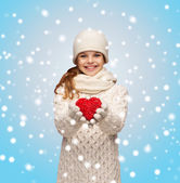 Girl in winter clothes with small red heart — Stock Photo