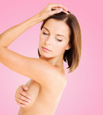 Woman checking breast for signs of cancer — Stock Photo