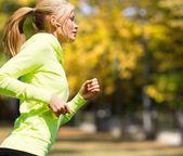 Woman doing running outdoors — Stock Photo