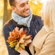 Romantic couple in the autumn park — Foto Stock