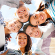 Stock Photo: Group of teenagers looking down