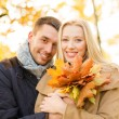 Romantic couple in the autumn park — Stock Photo